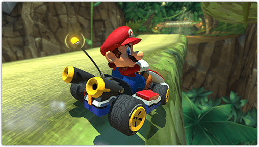 Mario drives his kart dangerously close to the edge but stays on the track.